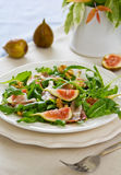 Fig,Prosciutto with walnut and rocket salad Royalty Free Stock Photos