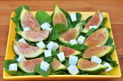 Fig salad with arugula and feta cheese Royalty Free Stock Image