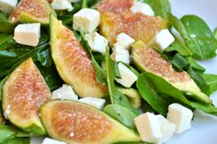 Fig salad with arugula and feta cheese Royalty Free Stock Photos