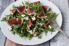 Fig salad. With arugula, roquefort and walnuts Stock Photos