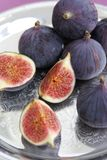 Fig on a silver plate royalty free stock photo