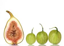 Fig and Three Goosberries Royalty Free Stock Photos