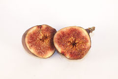 Fig. Two halves of purple figs, isolated on white background Royalty Free Stock Photo