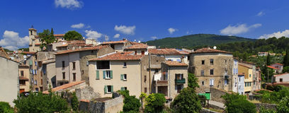 Figanières with Chapelle St Michel standing above the provence houses of the village Stock Image
