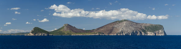 Figaro cape, Sardinia, Italy. Panoramic view of Figaro cape from the ship, Sardinia, Italy stock photo