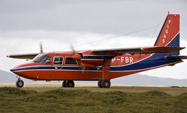 'FIGAS' aircraft - Falkland Islands. 'FIGAS' (Falkland Islands Government Air Services) Bitten-Norman Islander twin engined aircraft landing at Saunders Island Royalty Free Stock Images