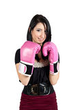 Fighing for Your Business. Pretty young business woman with boxing gloves Stock Image