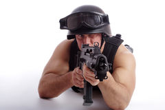 Fight. Shot of a soldier holding gun. Uniform conforms to special services(soldiers) of the NATO countries. Shot in studio. Isolated on white royalty free stock images