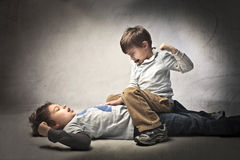 Fight. Two little brothers fighting and quarreling Royalty Free Stock Image