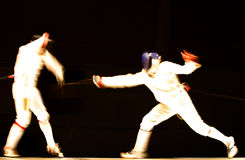 Fight. An action photography with two fencers Stock Photo