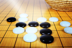 A fight. The game of go under a beam of light royalty free stock photos