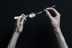 The fight against drugs and drug addiction topic: hand addict lies on a dark table and around it are drugs, a top studio. The fight against drugs and drug royalty free stock image