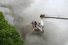 Fight against a fire. Extinguishing of fire, reporting about work of firemen Stock Image