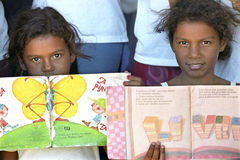 Fight against illiteracy through mobile library, Brazil. North East Brazil, state, Bahia state, district Gurigi in the village of Conde: many Brazilian children Royalty Free Stock Photo