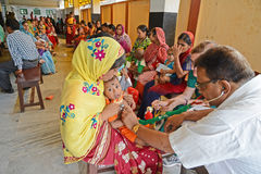 Fight Against Malnutrition. A doctor examine the child health at the clinic center,Half of India's children under the age of five are malnourished Stock Photos
