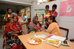 Fight Against Malnutrition. A lady doctor examine the child health at the clinic center,Half of India's children under the age of five are malnourished Royalty Free Stock Photos
