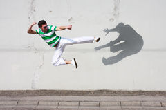 Fight against the own shadow. Man fighting against his own shadow Stock Images