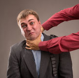 Fight. Aggressive office worker put up a fight Royalty Free Stock Photography