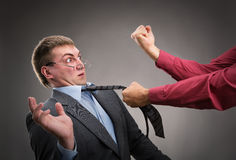 Fight. Aggressive office worker put up a fight Royalty Free Stock Photo