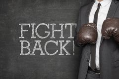 Fight back on blackboard with businessman Royalty Free Stock Photos