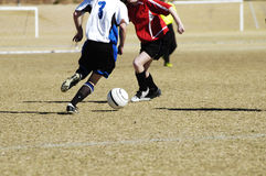 Fight for the ball 1. A fight for the soccer ball in a youth soccer game royalty free stock photos