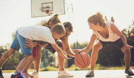 Fight for ball. Family playing basketball stock image