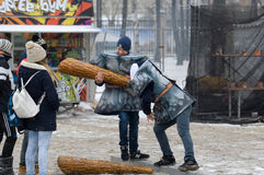 Fight on big sticks. MOSCOW, RUSSIA - NOVEMBER 10, 2016: Unidentified teens fight on big stickson city event of open Winter game season on November 11, 2016, in royalty free stock image