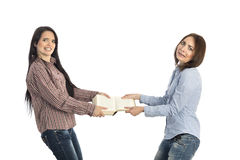 Fight for book two young females pulling book Stock Photography