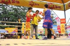 Fight boxing. SURAT THANI, THAILAND - DECEMBER 14 : Usanakorn Kokietgym WBC Super Flyweight Champion fight boxing with Leeyunting on December 14, 2012 in Surat royalty free stock photography