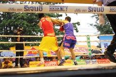 Fight boxing. SURAT THANI, THAILAND - DECEMBER 14 : Usanakorn Kokietgym WBC Super Flyweight Champion fight boxing with Leeyunting on December 14, 2012 in Surat stock image