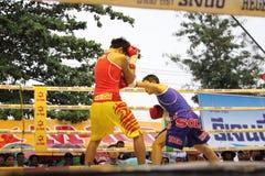 Fight boxing. SURAT THANI, THAILAND - DECEMBER 14 : Usanakorn Kokietgym WBC Super Flyweight Champion fight boxing with Leeyunting on December 14, 2012 in Surat royalty free stock photos