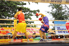Fight boxing. SURAT THANI, THAILAND - DECEMBER 14 : Usanakorn Kokietgym WBC Super Flyweight Champion fight boxing with Leeyunting on December 14, 2012 in Surat royalty free stock photo