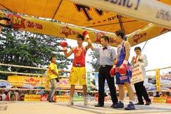 Fight boxing. SURAT THANI, THAILAND - DECEMBER 14 : Usanakorn Kokietgym WBC Super Flyweight Champion wins fight boxing over Leeyunting on December 14, 2012 in royalty free stock image