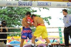 Fight boxing. SURAT THANI, THAILAND - DECEMBER 14 : Ratchasak Sitmoaseng and Shucheelhong fight boxing on December 14, 2012 in Surat Thani, Thailand royalty free stock image