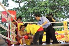 Fight boxing. SURAT THANI, THAILAND - DECEMBER 14 : Ratchasak Sitmoaseng break during fight boxing with Shucheelhong on December 14, 2012 in Surat Thani stock photos