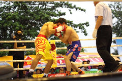 Fight boxing. SURAT THANI, THAILAND - DECEMBER 14 : Decha Kokietgym and Chenyujie fight boxing on December 14, 2012 in Surat Thani, Thailand stock photo
