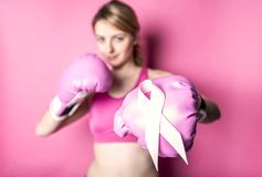 Fight for Breast Cancer woman with symbol on pink background Stock Images