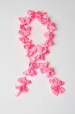 Fight cancer sign made of pink ribbons Royalty Free Stock Images