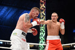 Fight for champions belt. Lviv, UKRAINE -October 4, 2014 : Oleksandr Usyk (Ukraine) and South African Daniel Bruwer in the ring during fight for WBO Inter stock photo