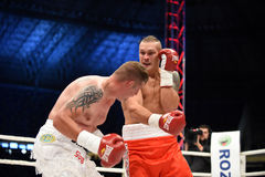 Fight for champions belt. Lviv, UKRAINE -October 4, 2014 : Oleksandr Usyk (Ukraine) and South African Daniel Bruwer in the ring during fight for WBO Inter royalty free stock image