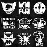 Fight Clubs Emblems. With cityscape chain bat fist skull warrior wings on black background isolated vector illustration Stock Photo