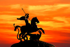 Fight with the evil. Monument to Saint George and the Dragon on sunset background. The monument is located in the Moscow (Russia). Saint George the Victorious is Stock Image