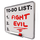 Fight Evil Words To Do List Protect Secure Improve Safety. Fight Evil words on a to do list written on a dry erase board to remind you to protect other people Stock Photography