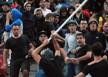 Fight between football supporters in Romania-Hungary Royalty Free Stock Photo