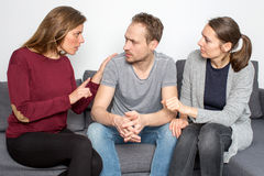 Fight between friends. Woman discussing with men with friend listening stock images