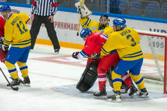 The fight at the gates. MOSCOW - JANUARY 29, 2016: The fight at the gates of Swedish team Goalkeeper Rolf Wanhainen (1) on hockey game Sweden vs Czech Republic royalty free stock image