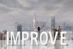 Fight for improve. Concept images with 3d text and asian business woman under sky Stock Photography