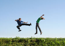 Fight in jump. Two men make sport Stock Image