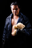 Fight For Kid. Boxer holding a teddy bear royalty free stock photography