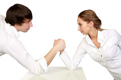 Fight of man and woman. Fight of stronger and fair sex. Man and woman on a white background Royalty Free Stock Images